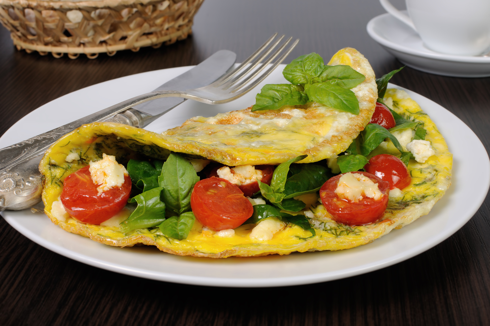 Omelet with spinach, basil, cherry tomatoes and cheese Adyg